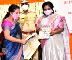 Free Photo: Telangana governor felicitates Col Santosh Babu's wife.