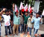TRS protest against Andhra Pradesh CM and Revanth Reddy