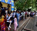 Telangana Secretariat employees queue-up to collect cash