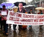 Temporary teachers offer a chapati to a cutout of West Bengal Education