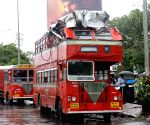 Double-decker bus crashes into an overhead railing