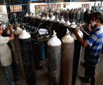 Patna : The employees refilling cylinders at a medical oxygen plant, in Patna