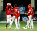 File Photo: The Kings XI Punjab players celebrates a wicket of Royal Challengers Bangalore during a match