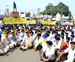 SGPC protest against desecration of their holy book