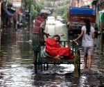 The poor sick woman left the cycle van and went to the hospital wade through a waterlogged road during heavy rain in Kolkata.