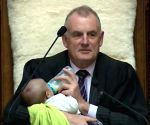 NZ Speaker cradles MP's baby in parliament