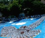 """Thousands of students make a human formation of a """"Dove flying in the Sky"""""""