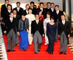 Japan's Prime Minister Shinzo Abe (C, front) and other members of the new Cabinet pose for a group photo at the prime minister official residence