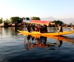 Tourists enjoy a Shikara ride on Dal Lake