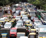 : Bengaluru: Traffic jam at Corporation Circle during Kisan Bharat Bandh against three central government's agricultural reform laws, in Bengaluru