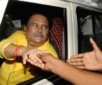 Madan Mitra being taken to jail