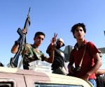 Libya Dawn militants sit in a truck mounted with anti-aircraft guns