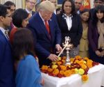 Free Photo: Trump lights lamp in Oval Office, wishes Happy Diwali