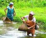 Two Bodo women fishing with traditional Jekhai and Khobai