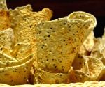 Un-fried 'Fryums' not 'Papad', hence taxable at 18%
