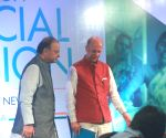 Arun Jaitly addresses a conclave on financial inclusion