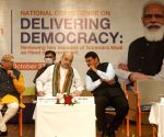 :Union Home Minister Amit Shah with Former Maharashtra Chief Minister Devendra Fandnavis during the inaugural session of National Conference on Delivering Democracy, Reviewing Two Decades of PM Nrendra Modi as head of the Government.