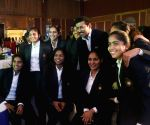 Rajyavardhan Singh Rathore with Indian women's hockey team at a felicitation programme