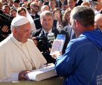 : (171016) Vatican City: Pope holds Sri Chinmoy Oneness Home Peace Torch