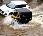 :Mysore:Vehicles wade through a flooded Mysuru ring road after Bogadi lake overflowed due to heavy rainfall.