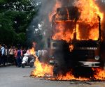 Protesters torch vehicles with Tamil Nadu registration numbers