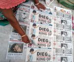 Free Photo: Vendor arrange News papers of Maradona in Kolkata on Nov 26, 2020.