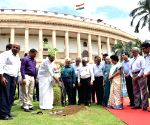 Venkaiah Naidu plants a tree at Parliament premises on completion of two years in office