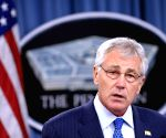 U.S. Secretary of Defense Chuck Hagel and Japanese Defense Minister Itsunori Onodera attend a press briefing after their meeting at the Pentagon
