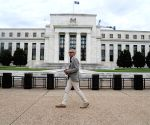 US economic activity picks up, but below pre-pandemic level