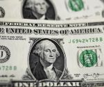 US dollar rises amid falling sterling