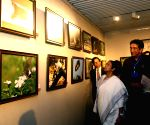 Mamata Banerjee during inauguration of Sabyasachi Chakrabarty's photo exhibition