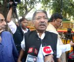 Somendra Nath Mitra talks to the media