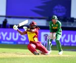 :Dubai:West Indies' Chris Gayle falls as he swings at the ball  during the Cricket Twenty20 World Cup match between South Africa and West Indies in Dubai,