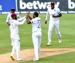 West Indies' Gabriel takes 2, SA's Elgar slams 77 as honours even on Day I