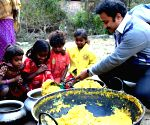 File Photos: This Bengal teacher collects, cooks food to feed the impoverished