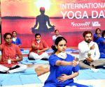 Wockhardt Hospital, Mumbai Central doctors, nurses and ward boys attending a yoga session on World International Yoga Day on in Mumbai
