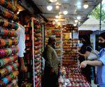 : New Delhi:Women buys bangles on the eve of Karva Chauth,