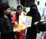 Women celebrate the passage of Triple Talaq bill in Parliament