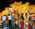 Women perform rituals ahead of Durga idol immersion at Ekdalia Evergreen Club community puja pandal