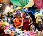 : Kolkata :Women shop at a Market ahead of Diwali Festival .