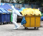 Worker of Lok Nayak Jai Prakash Hospital (LNJP) wearing PPE suits during the Biometric wastage (BMW) dump at LNJP (BMW) storage area in New Delhi