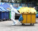 Worker of Lok Nayak Jai Prakash Hospital (LNJP) wearing PPE suits during the Biometric wastage (BMW) dump at LNJP (BMW) storage area in New Delhi