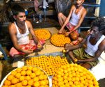 Workers busy preparing laddus on the eve of counting day