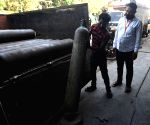Workers load medical oxygen cylinders for hospital use on Covid-19 coronavirus patients amid the rising cases in Mumbai