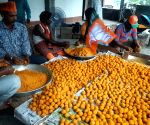 Workers busy preparing laddus