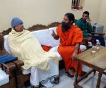 Ramdev calls on Lalu Yadav
