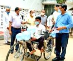 Yogi gives tricycle to man with disability