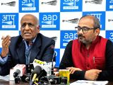 AAP leaders N.D.Gupta and Dilip Pandey address a press conference in New Delhi, on Feb 16, 2018.