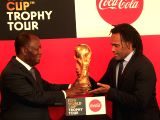 ABIDJAN, March 14, 2018 - Cote d'Ivoire's president Alassane Ouattara (L) and former French football player Christian Karembeu hold the FIFA World Cup Trophy during the FIFA World Cup Trophy world ...