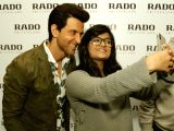 Actor Hrithik Roshan poses for selfies during the launch of a watch store in New Delhi on Feb 14, 2018.